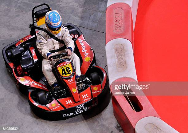 Formula one driver Fernando Alonso steers his kart through a curve during the 'Iker Vs Rafa' charity game at the Palacio de Deportes de la Comunidad...