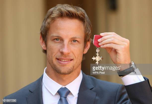 Formula One driver Jenson Button poses with his MBE which he received from Queen Elizabeth II, at Buckingham Palace, on June 02, 2010 in London,...