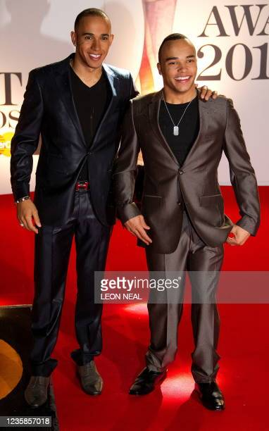 Formula One driver Lewis Hamilton and half-brother Nicholas Hamilton arrive at the o2 arena in east London ahead of the Brit Awards on February 15,...