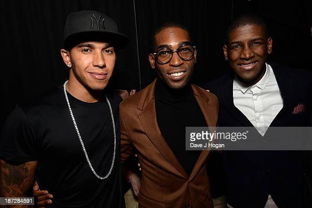 Formula One driver Lewis Hamilton Tinie Tempah and Labrinth pose during the Beats by Dre present Tinie Tempah's album launch party at DSTRKT on...