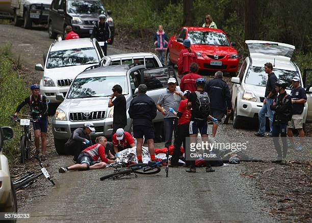 Formula One driver Mark Webber receives medical attention at the scene after a collision with a car during day four of the Mark Webber Pure Tasmania...