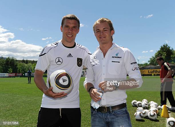 Formula one driver Nico Rosberg poses with Lukas Podolski after a training session of the German National Team at Sportzone Rungg on June 01, 2010 in...