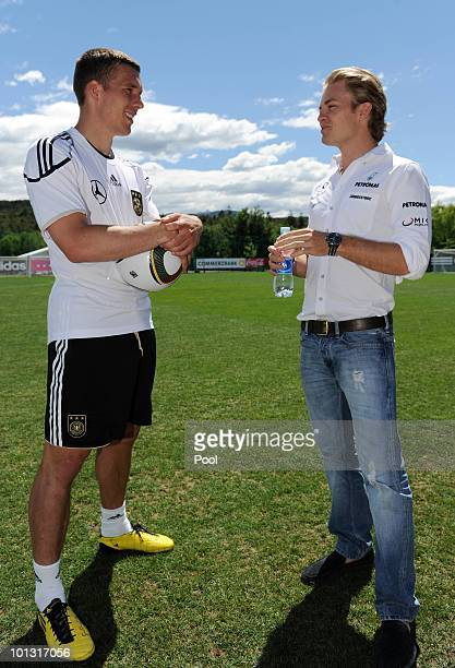 Formula one driver Nico Rosberg talks to Lukas Podolski after a training session of the German National Team at Sportzone Rungg on June 01, 2010 in...