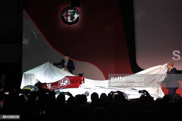 Formula One drivers Charles Leclerc of Monaco and Marcus Ericsson of Sweden unveil the new Alfa Romeo Sauber Formula One Team car on December 2 2017...
