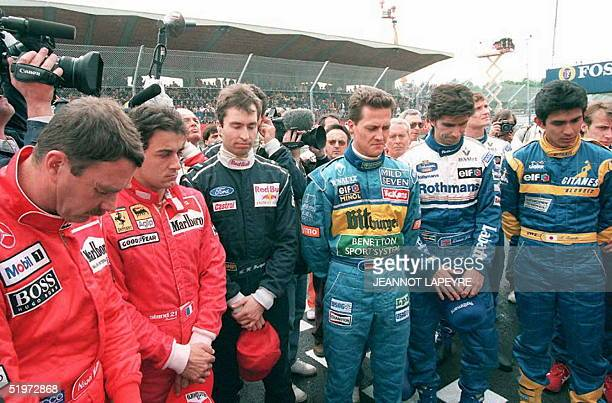 Formula One drivers observe a minute of silence to commemorate the first anniversary of the death of fellow dirvers Ayrton Senna of Brazil and Roland...