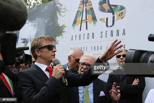 Formula One Ferrari driver Kimi Raikkonen pays tribute to Brazilian's F1 driver Ayrton Senna during a ceremony to commemorate the 20th anniversary of...