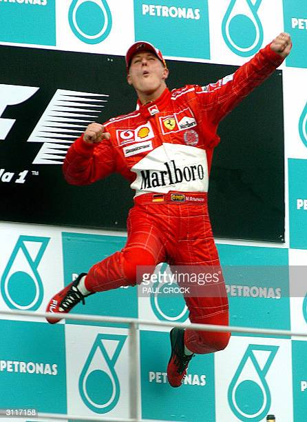 Formula One Ferrari driver Michael Schumacher jumps in celebration after winning the Malaysian Grand Prix in Sepang 21 March 2004 World Champion...