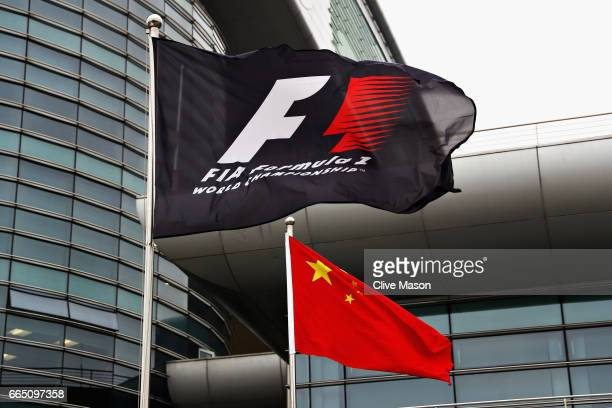 Formula One flag and the Chinese flag fly in the Paddock during previews to the Formula One Grand Prix of China at Shanghai International Circuit on...