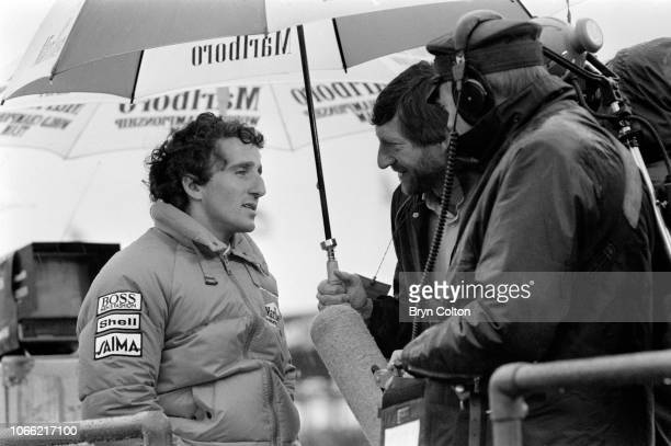 Formula One Grand Prix racing driver Alain Prost driving for McLarenTAG speaks to a television crew during a qualifying session for the 1985 British...