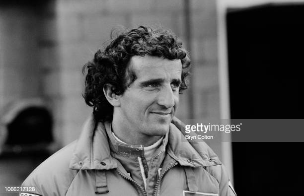 Formula One Grand Prix racing driver Alain Prost driving for McLarenTAG stands in the pit lane during a qualifying session for the 1985 British Grand...