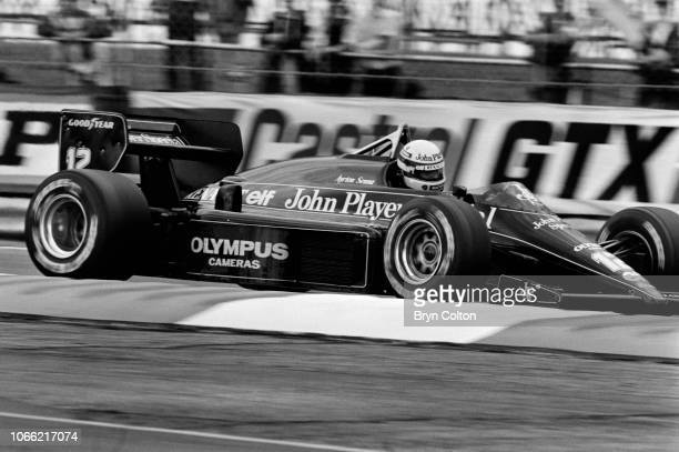 Formula One Grand Prix racing driver Aryto Senna, driving for Lotus-Renault in the John Player Special , drives the car during a qualifying session...