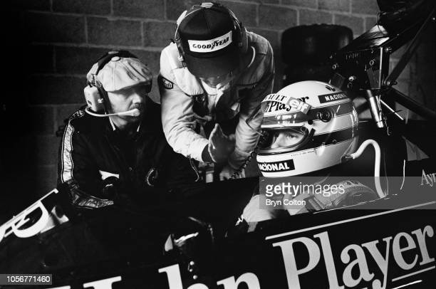Formula One Grand Prix racing driver Ayrton Senna driving for LotusRenault in the 97T John Player Special sits in the car alongside mechanics during...
