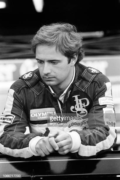 Formula One Grand Prix racing driver Elio de Angelis driving for LotusRenault in the John Player Special stands in the pit lane during a qualifying...