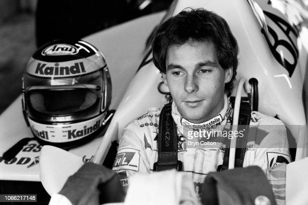 Formula One Grand Prix racing driver Gerhard Berger driving for ArrowsBMW sits in his car in the pit lane garage ahead of competing in a qualifying...