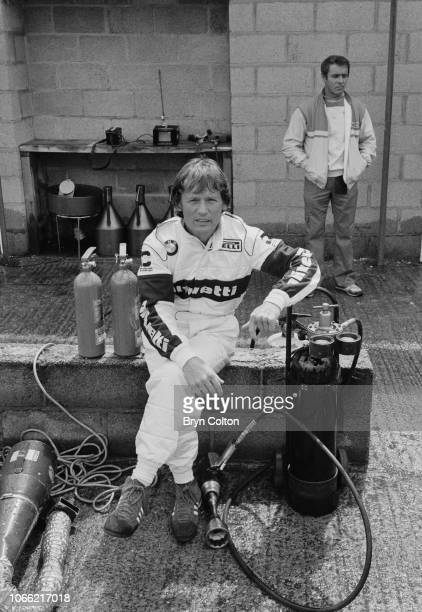 Formula One Grand Prix racing driver Marc Surer driving for BrabhamBMW sits in the pit lane during a qualifying session for the 1985 British Grand...