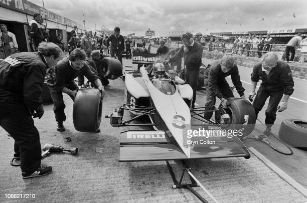Formula One Grand Prix racing driver Marc Surer driving for BrabhamBMW sits in the car during pit stop for a tyre change whilst competing in the...