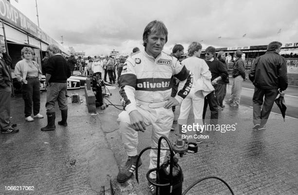 Formula One Grand Prix racing driver Marc Surer driving for BrabhamBMW stands in the pit lane during a qualifying session for the 1985 British Grand...