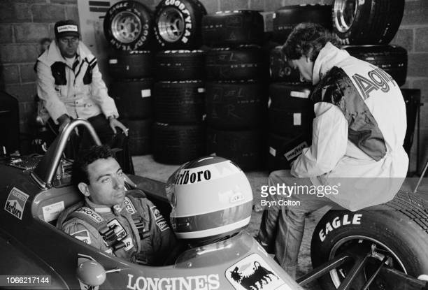 Formula One Grand Prix racing driver Michele Alboreto driving for Ferrari sits waiting in his car ahead of competing in a qualifying session for the...