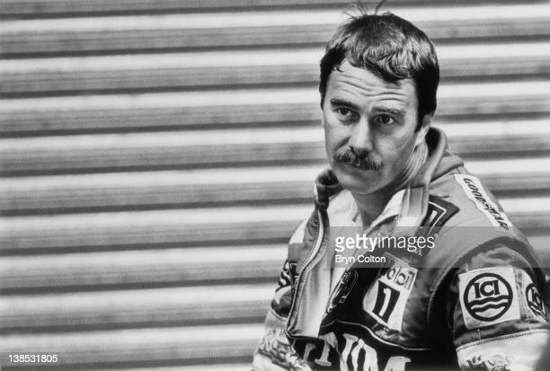 Formula One Grand Prix racing driver Nigel Mansell driving for WilliamsHonda pauses in the teams pit lane garage after a qualifying session ahead of...