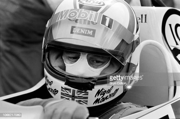 Formula One Grand Prix racing driver Nigel Mansell driving for WilliamsHonda sits in his car in the pit lane during a qualifying session for the 1985...