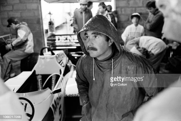 Formula One Grand Prix racing driver Nigel Mansell driving for WilliamsHonda watches the lap times of drivers on a screen whilst standing in his pit...