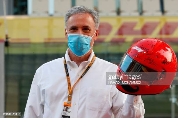 Formula One Group CEO Chase Carey poses for a picture with signed helmet ahead of the Abu Dhabi Formula One Grand Prix at the Yas Marina Circuit in...