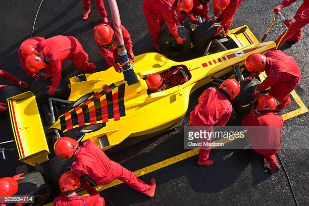formula one racecar in pit box during pit stop - race car driver stock pictures, royalty-free photos & images