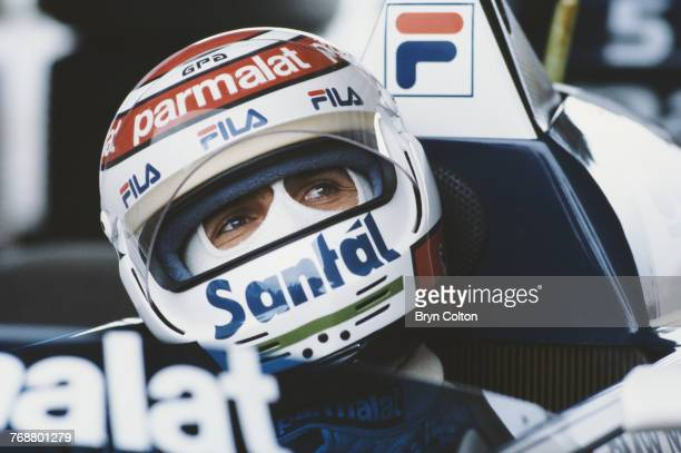 Formula One racing driver Nelson Piquet driving for BMWBrabham in his car in the team garage ahead of the 1983 Dutch Grand Prix at the Zandvoort...