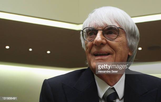 Formula One supremo Bernie Ecclestone smiles as he arrives as witness for the trial against former CEO of Bayerische Landesbank and Formula One...