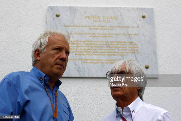 Formula One supremo Bernie Ecclestone speaks to the FIA race director Charlie Whiting after a ceremony in memory of recently deceased Hungarian...
