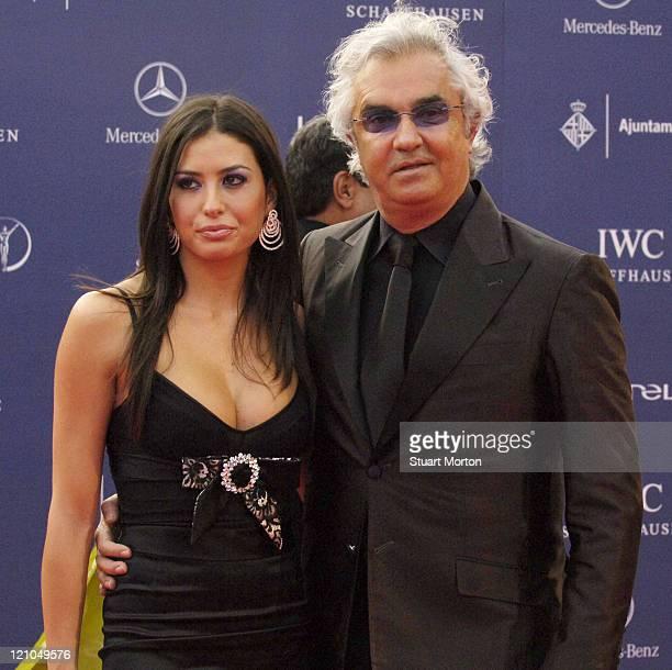Formula one team boss Flavio Briatore and his partner