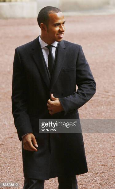 Formula One world champion Lewis Hamilton arrives at Buckingham Palace where he is to be awarded an MBE by Queen Elizabeth II on March 10 2009 in...