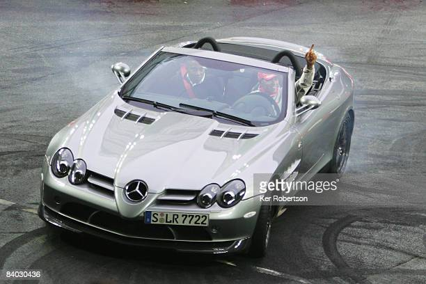 Formula One World Champion Lewis Hamilton of Great Britain and McLaren Mercedes performs donuts as he takes his father Anthony Hamilton for a ride...