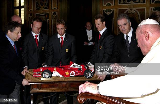 Formula One world champion Michael Schumacher and the rest of the Ferrari team met the Pope in the Vatican's frescoed Clementina Hall to give him the...
