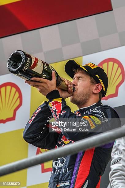 Formula One World Championship 2013, F1 Shell Belgian Grand Prix, #1 Sebastian Vettel of the Red Bull F1 team on the winners podium with champagne on...