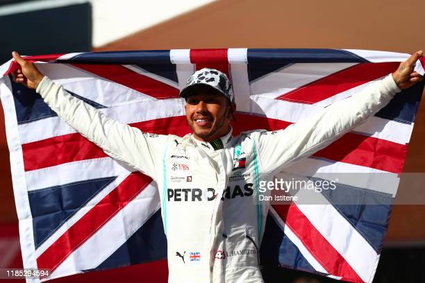 Formula One World Drivers Champion Lewis Hamilton of Great Britain and Mercedes GP celebrates in parc ferme during the F1 Grand Prix of USA at...