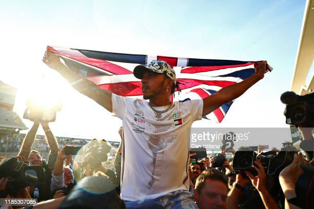 Formula One World Drivers Champion Lewis Hamilton of Great Britain and Mercedes GP celebrates after the F1 Grand Prix of USA at Circuit of The...