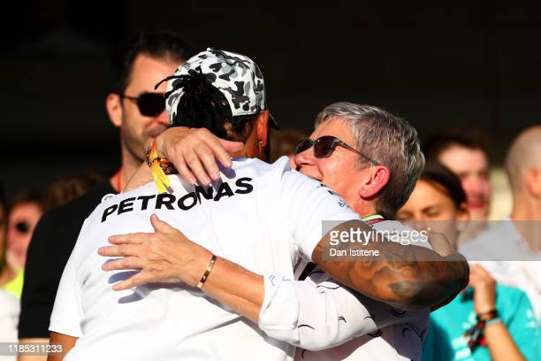 Formula One World Drivers Champion Lewis Hamilton of Great Britain and Mercedes GP celebrates with his mother Carmen Larbalestier after the F1 Grand...
