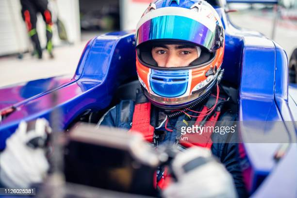 formula race car driver - motorsport event stock pictures, royalty-free photos & images