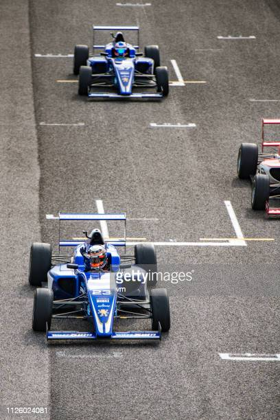 formula race car driver waving after winning - grand prix motor racing stock pictures, royalty-free photos & images