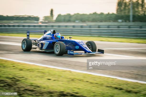 formula race car going fast on the track - grand prix motor racing stock pictures, royalty-free photos & images