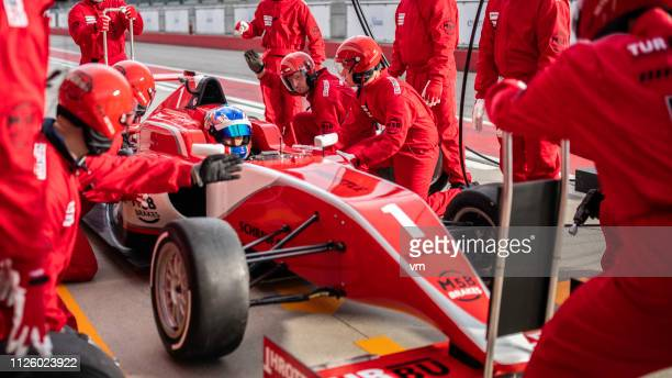 formula race car in a pit stop - pit stop stock pictures, royalty-free photos & images