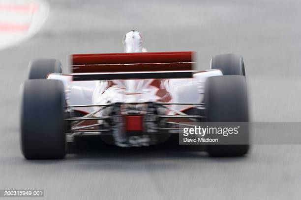 Formula race car, rear view (blurred motion)