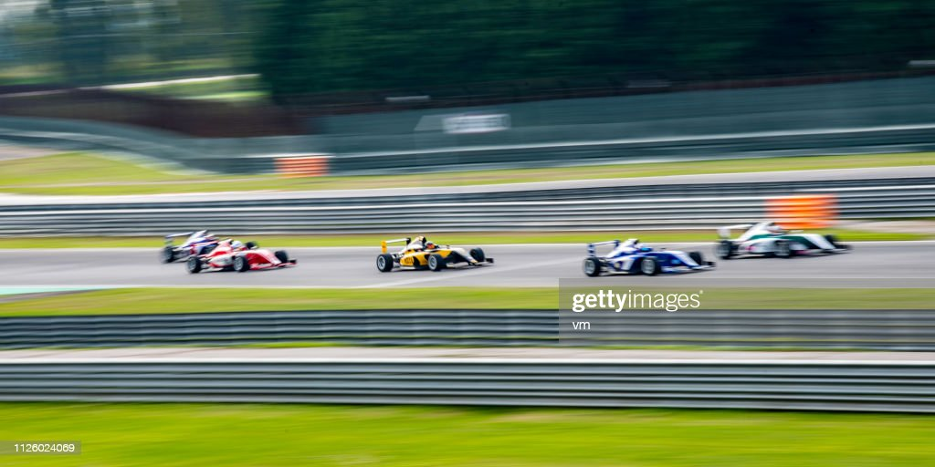 Formula race cars driving fast : Stock Photo