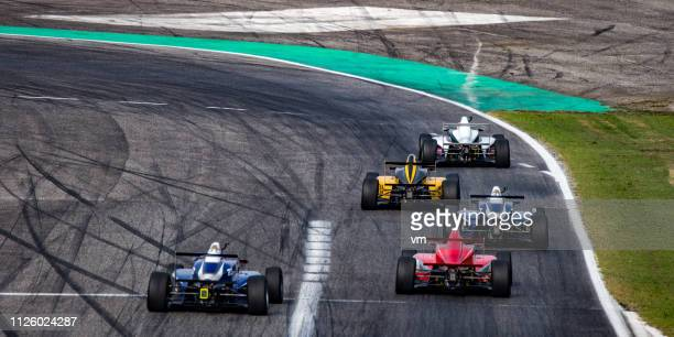 formula race cars on the track - racing driver stock pictures, royalty-free photos & images