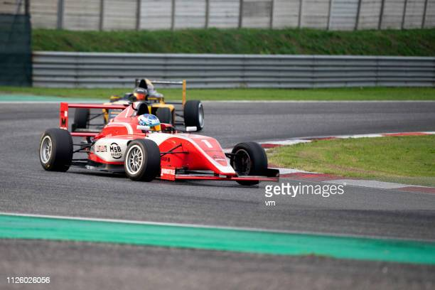 formula race cars on the track - grand prix motor racing stock pictures, royalty-free photos & images