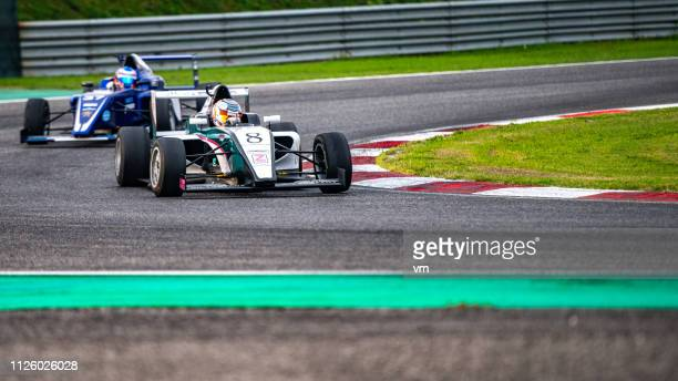 formula race - grand prix motor racing stock pictures, royalty-free photos & images