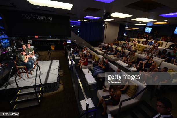 Forrest Griffin and Matt Hughes interact with fans during a UFC Fight Week Party at Lagasse's Stadium on July 5 2013 in Las Vegas Nevada