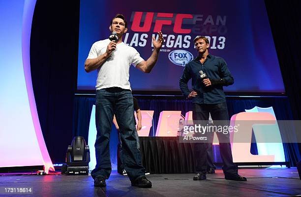 Forrest Griffin and Stephan Bonnar address the fans after being inducted into the UFC Hall of Fame during the UFC Fan Expo Las Vegas 2013 at the...