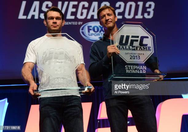 Forrest Griffin and Stephan Bonnar pose for photos with their UFC Hall of Fame plaques during the UFC Fan Expo Las Vegas 2013 at the Mandalay Bay...